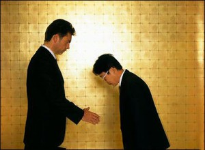 two men bowing to greet eachother