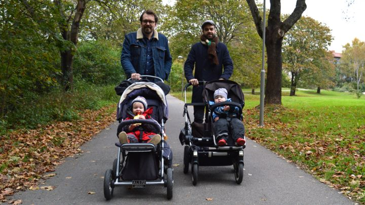 Dads take babies a walk in the park in their strollers