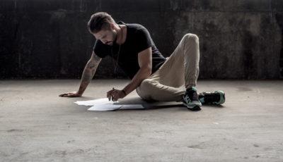 Translator writing script on the floor.