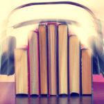 headphones over books symbolising audiobook recordings